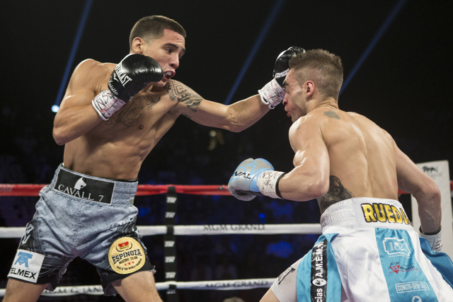 Oscar Valdez Jr., left, connects a left punch against Matias Rueda in the featherweight title bout for the vacant WBO World Title at the MGM Grand Garden Arena on Saturday, July 23, 2016, in Las V ...