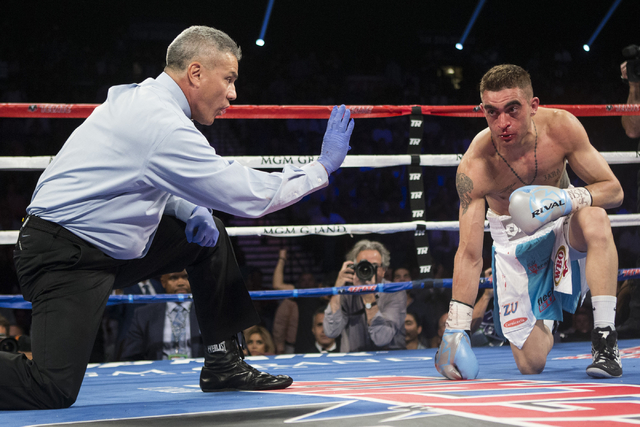 Matias Rueda gets a count after taking a knee against Oscar Valdez Jr. in the featherweight title bout for the vacant WBO World Title at the MGM Grand Garden Arena on Saturday, July 23, 2016, in L ...