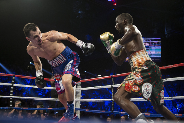 Viktor Postol, left, stumbles against Terence Crawford in the WBO and WBC World Title bout at the MGM Grand Garden Arena on Saturday, July 23, 2016, in Las Vegas.(Erik Verduzco/Las Vegas Review-Jo ...