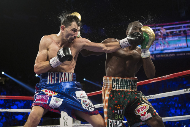 Viktor Postol, left, battles Terence Crawford in the WBO and WBC World Title bout at the MGM Grand Garden Arena on Saturday, July 23, 2016, in Las Vegas.(Erik Verduzco/Las Vegas Review-Journal) Fo ...