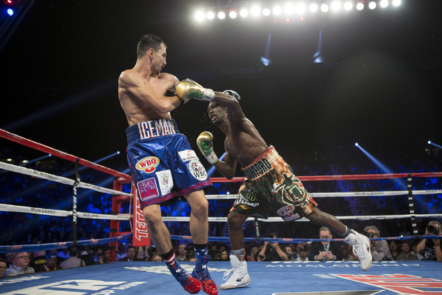 Terence Crawford, right, throws a left punch against Viktor Postol in the WBO and WBC World Title bout at the MGM Grand Garden Arena on Saturday, July 23, 2016, in Las Vegas. (Erik Verduzco/Las Ve ...