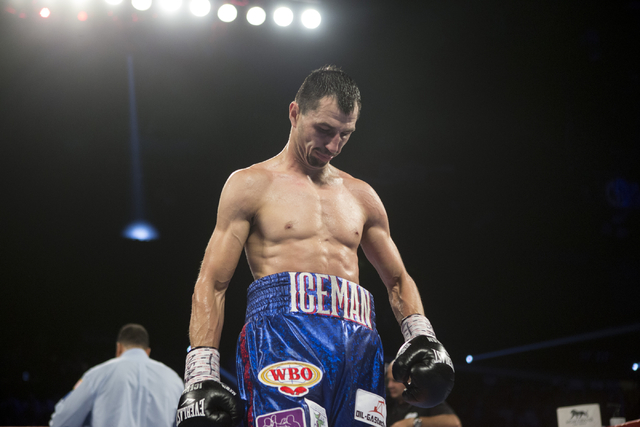 Viktor Postol, left, lowers his head as he walks to the corner in between round against  Terence Crawford in the WBO and WBC World Title bout at the MGM Grand Garden Arena on Saturday, July 23, 20 ...