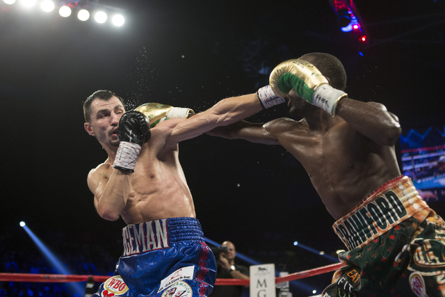 Terence Crawford, right, throws a right punch against Viktor Postol in the WBO and WBC World Title bout at the MGM Grand Garden Arena on Saturday, July 23, 2016, in Las Vegas. (Erik Verduzco/Las V ...