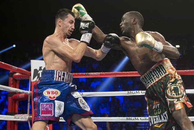 Terence Crawford, right, lands a right punch against Viktor Postol in the WBO and WBC World Title bout at the MGM Grand Garden Arena on Saturday, July 23, 2016, in Las Vegas. (Erik Verduzco/Las Ve ...