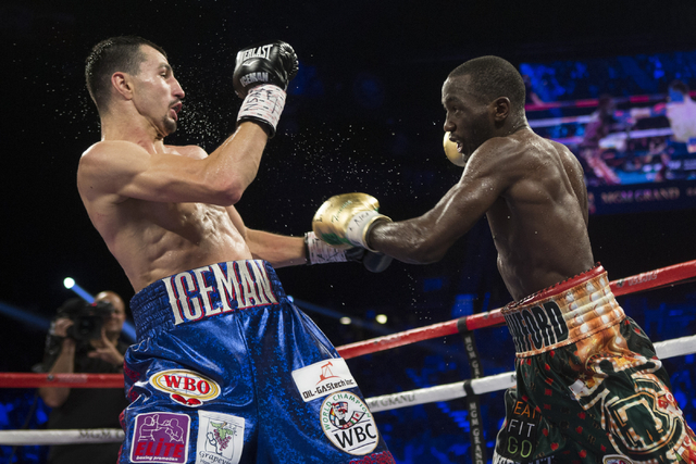 Viktor Postol, left, battles Terence Crawford in the WBO and WBC World Title bout at the MGM Grand Garden Arena on Saturday, July 23, 2016, in Las Vegas. Crawford won by unanimous decision. (Erik  ...