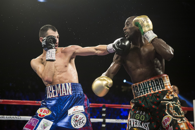 Viktor Postol, left, connects a left punch against Terence Crawford in the WBO and WBC World Title bout at the MGM Grand Garden Arena on Saturday, July 23, 2016, in Las Vegas. (Erik Verduzco/Las V ...