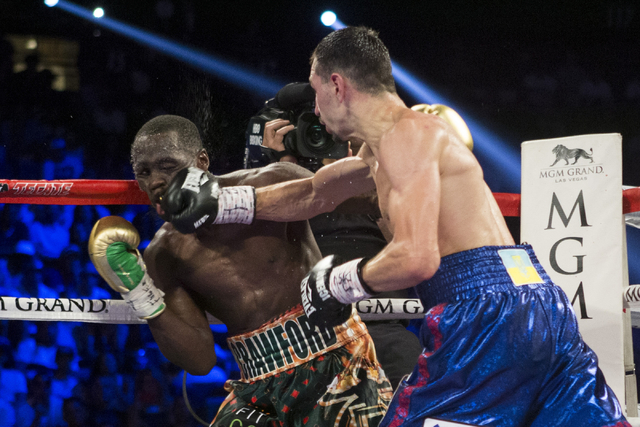 Viktor Postol, right, connects a right punch against Terence Crawford in the WBO and WBC World Title bout at the MGM Grand Garden Arena on Saturday, July 23, 2016, in Las Vegas. (Erik Verduzco/Las ...