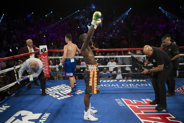 Terence Crawford raises his arms in victory after the 12 round WBO and WBC World Title bout against Viktor Postol at the MGM Grand Garden Arena on Saturday, July 23, 2016, in Las Vegas. (Erik Verd ...