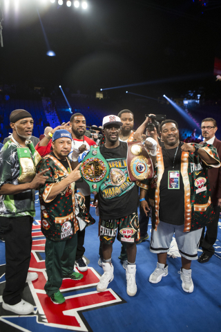Terence Crawford is photographed with his team after his victory against Viktor Postol in the WBO and WBC World Title bout at the MGM Grand Garden Arena on Saturday, July 23, 2016, in Las Vegas. ( ...
