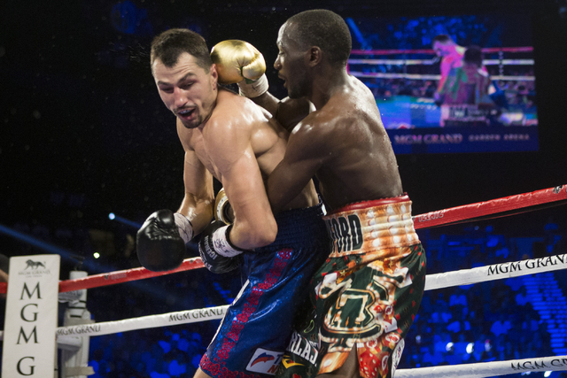 Viktor Postol, left, takes a punch to the back of the head from Terence Crawford in the WBO and WBC World Title bout at the MGM Grand Garden Arena on Saturday, July 23, 2016, in Las Vegas.(Erik Ve ...