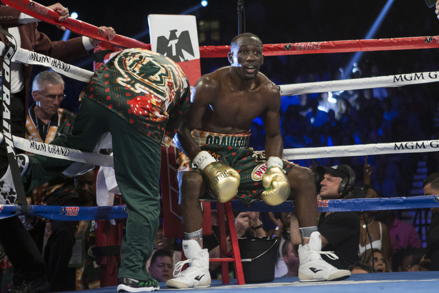 Terence Crawford sits at his corner in between fight rounds against Viktor Postol in the WBO and WBC World Title bout at the MGM Grand Garden Arena on Saturday, July 23, 2016, in Las Vegas.(Erik V ...