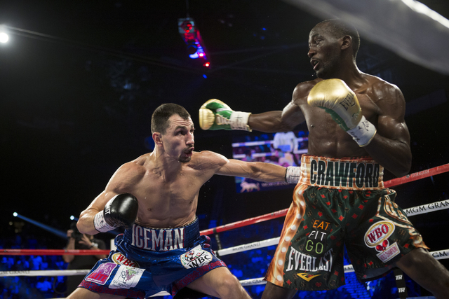 Viktor Postol, left, battles Terence Crawford in the WBO and WBC World Title bout at the MGM Grand Garden Arena on Saturday, July 23, 2016, in Las Vegas. (Erik Verduzco/Las Vegas Review-Journal) F ...