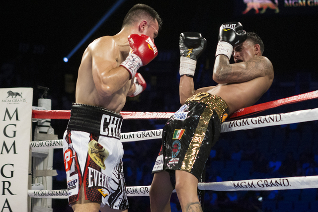 Jose Benavidez Jr., right, moves back to the ropes against Francisco Santana in the welterweight bout at the MGM Grand Garden Arena on Saturday, July 23, 2016, in Las Vegas. Jose Benavidez Jr. won ...