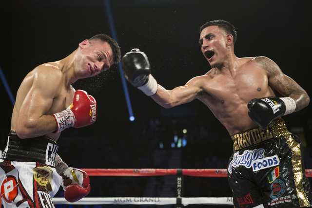 Jose Benavidez Jr., right, connects a right punch against Francisco Santana in the welterweight bout at the MGM Grand Garden Arena on Saturday, July 23, 2016, in Las Vegas. Jose Benavidez Jr. won  ...