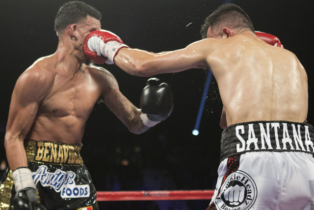 Francisco Santana, right, connects a left punch against Jose Benavidez Jr. in the welterweight bout at the MGM Grand Garden Arena on Saturday, July 23, 2016, in Las Vegas. Jose Benavidez Jr. won b ...