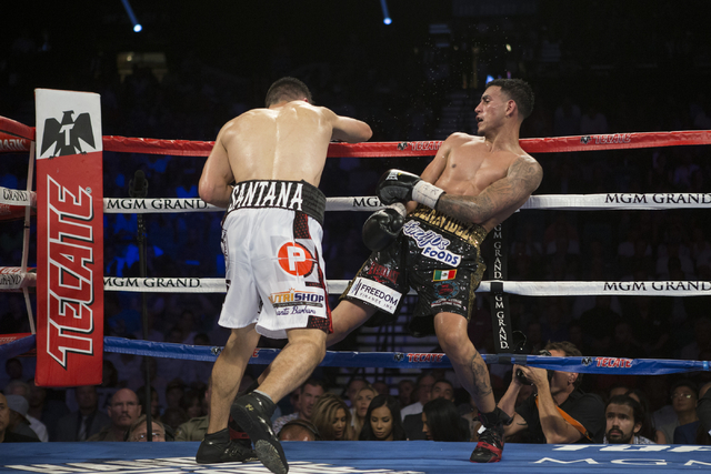 Jose Benavidez Jr., right, moves away from a punch against Francisco Santana in the welterweight bout at the MGM Grand Garden Arena on Saturday, July 23, 2016, in Las Vegas. Jose Benavidez Jr. won ...