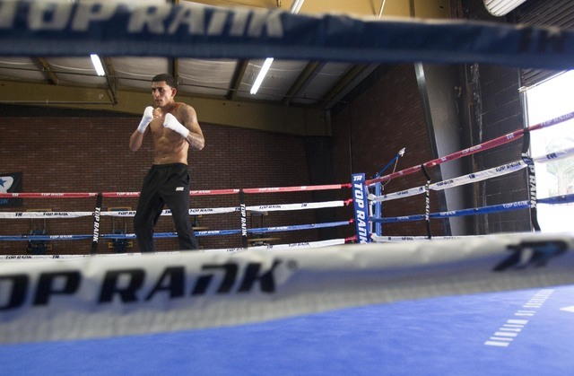 Welterweight boxer Jose Benavidez Jr. stands in the ring as he trains during media day workouts at the Top Rank boxing gym in Las Vegas on Tuesday, July 19, 2016. (Richard Brian/Las Vegas Review-J ...