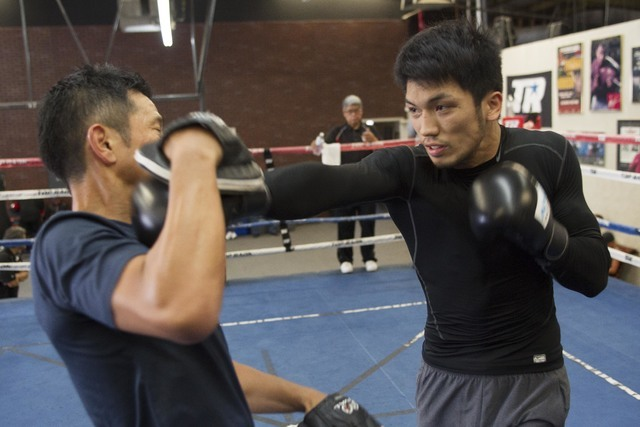 Japanese boxer Ryota Murata, right, hits the pads with trainer Sendai Tanaka during media day workouts at the Top Rank boxing gym in Las Vegas on Tuesday, July 19, 2016. (Richard Brian/Las Vegas R ...