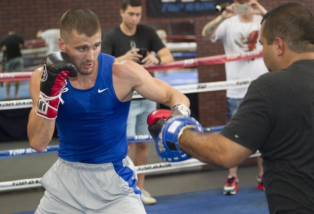 Ukrainian boxer Oleksandr Gvozdyk, left, trains with Marco Contreras during media day workouts at the Top Rank boxing gym in Las Vegas on Tuesday, July 19, 2016. (Richard Brian/Las Vegas Review-Jo ...