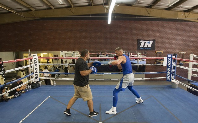 Ukrainian boxer Oleksandr Gvozdyk, right, trains with Marco Contreras during media day workouts at the Top Rank boxing gym in Las Vegas on Tuesday, July 19, 2016. (Richard Brian/Las Vegas Review-J ...