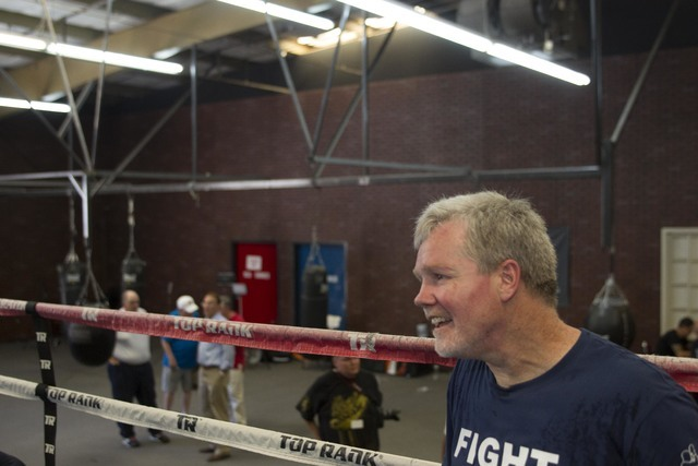 Boxing trainer Freddie Roach is seen in the ring while training Ukrainian boxer Viktor Postol during media day workouts at the Top Rank boxing gym in Las Vegas on Tuesday, July 19, 2016. (Richard  ...