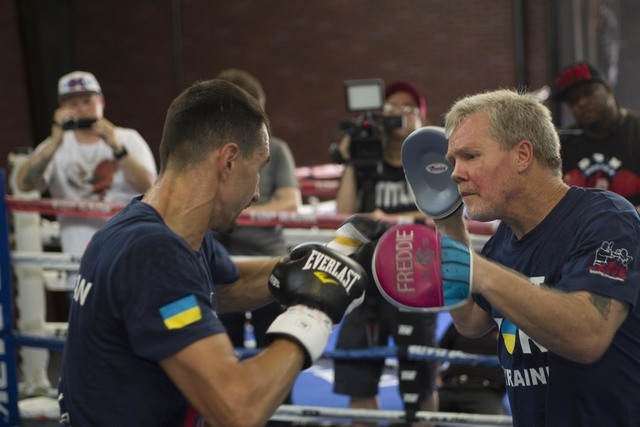 Ukrainian boxer Viktor Postol, left, hits the pads with trainer Freddie Roach during media day workouts at the Top Rank boxing gym in Las Vegas on Tuesday, July 19, 2016. (Richard Brian/Las Vegas  ...