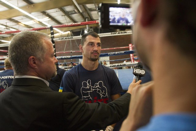 Ukrainian boxer Viktor Postol, center, speaks with news reporters during media day workouts at the Top Rank boxing gym in Las Vegas on Tuesday, July 19, 2016. (Richard Brian/Las Vegas Review-Journ ...