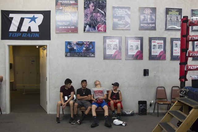 From left, aspiring boxers Juan Del Real, 13, Angel Martinez, 16, Felix Gonzalez, 15, and Julian Lugo, 12, wait for autograph and photo opportunities with boxers during media day workouts at the T ...