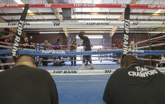 Boxer Terence Crawford shadow boxes in the ring during media day workouts at the Top Rank boxing gym in Las Vegas on Tuesday, July 19, 2016. (Richard Brian/Las Vegas Review-Journal) Follow @vegasp ...
