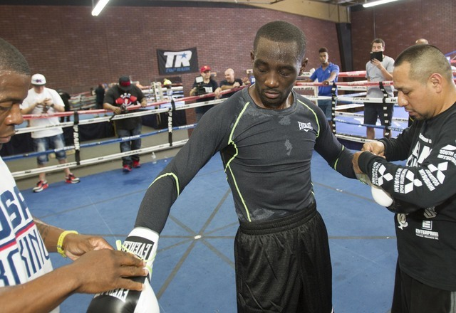 Boxer Terence Crawford, center, is assisted by members of his training camp during media day workouts at the Top Rank boxing gym in Las Vegas on Tuesday, July 19, 2016. (Richard Brian/Las Vegas Re ...