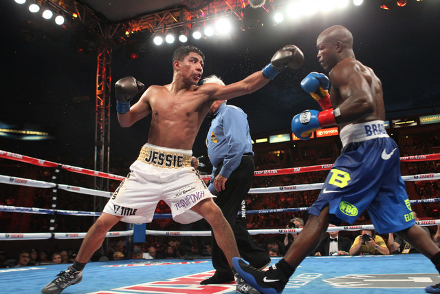 Timothy Bradley Jr., right, dodges a punch against Jessie Vargas in the ninth round of their World Boxing Organization interim welterweight title match at StubHub Center in Carson, Calif., on Satu ...