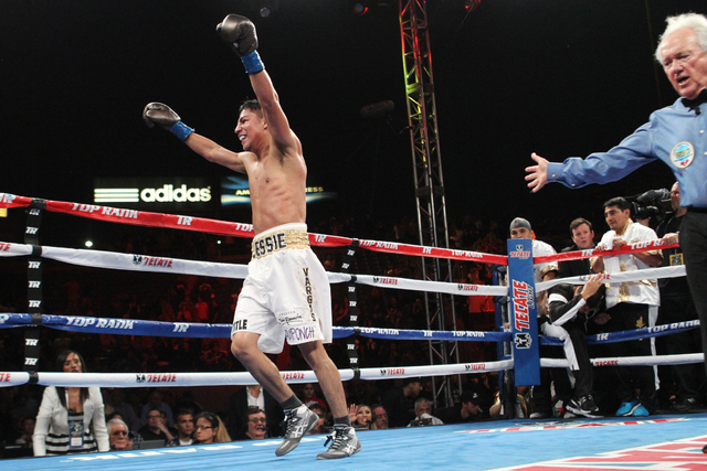Jessie Vargas reacts at the end of his fight against Timothy Bradley Jr. in the interim World Boxing Organization welterweight title match at StubHub Center in Carson, Calif., on Saturday, June 27 ...