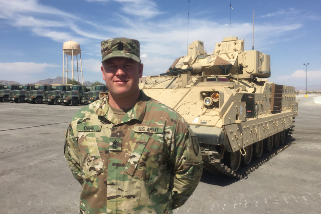 First Sgt. Michael Davis stands in front of one of the Nevada Army National Guard's new Bradley Fighting Vehicles at the Clark County Armory, Thursday, July 28, 2016. (Keith Rogers/Las Vegas Revie ...