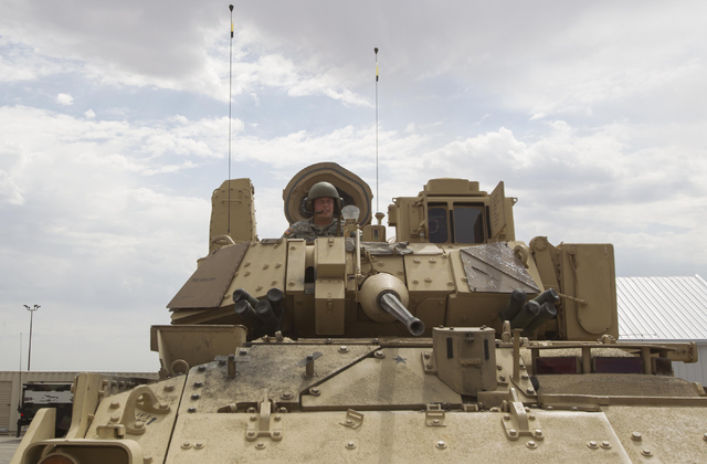 A Nevada National Guard soldier looks through the hatch of an A-3 Bradley fighting vehicle during a training exercise at the Clark County Armory on Friday, July 29, 2016. Richard Brian/Las Vegas R ...