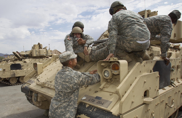 Nevada National Guard soldiers perform a casualty training exercise on the A-3 Bradley fighting vehicles at the Clark County Armory on Friday, July 29, 2016. Richard Brian/Las Vegas Review-Journal ...