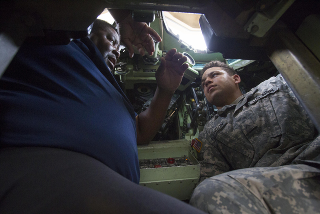 Training specialist Kenneth Pitts, left, goes over the A-3 Bradley fighting vehicle with Private Michael Barnson during a training exercise at the Clark County Armory on Friday, July 29, 2016. Ric ...