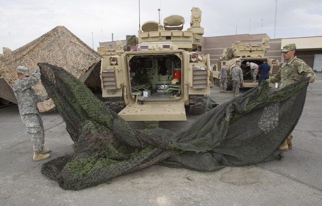 Nevada National Guard soldiers pack up their A-3 Bradley fighting vehicle following a training exercise on the A-3 at the Clark County Armory on Friday, July 29, 2016. Richard Brian/Las Vegas Revi ...