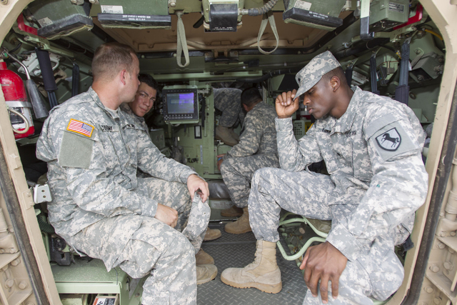 Nevada National Guard soldiers are seen in the back of an A-3 Bradley fighting vehicle during a training exercise at the Clark County Armory on Friday, July 29, 2016. Richard Brian/Las Vegas Revie ...