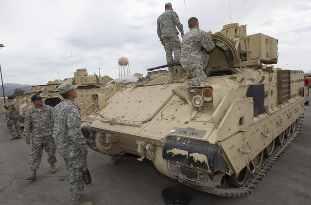 Nevada National Guard soldiers are seen on an A-3 Bradley fighting vehicle during a training exercise at the Clark County Armory on Friday, July 29, 2016. Richard Brian/Las Vegas Review-Journal Fo ...