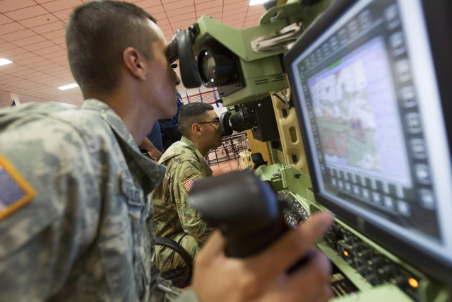 Nevada National Guard soldiers Michael Azcunaga, left, and Pedro Castillo are seen while training on a Bradley desktop simulator at the Clark County Armory on Friday, July 29, 2016. Richard Brian/ ...