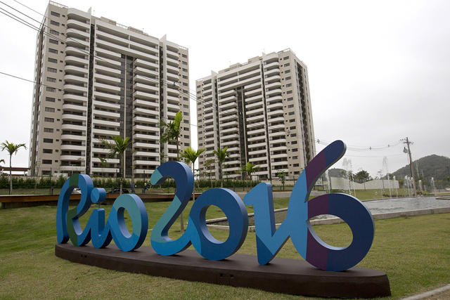 The Rio 2016 sign stands in front of the Olympic Village during a media tour in Rio de Janeiro, Brazil, Thursday, June 23, 2016. (Silvia Izquierdo/AP)