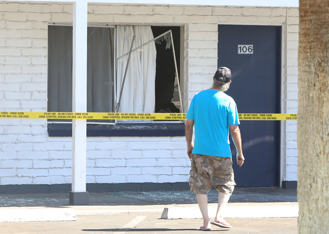 A man looks at the broken window of a room of Lamplighter Motel where Las Vegas police were responding to a barricade situation on Monday July 4, 2016 at 2805 Fremont St., in downtown. Bizuayehu T ...