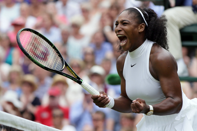 Serena Williams of the U.S celebrates after winning the first set against Angelique Kerber of Germany during the women's singles final on day thirteen of the Wimbledon Tennis Championships in Lond ...