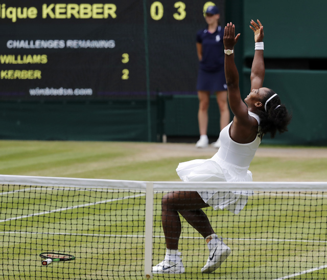 Serena Williams of the U.S celebrates after beating Angelique Kerber of Germany in the women's singles final on day thirteen of the Wimbledon Tennis Championships in London, Saturday, July 9, 2016 ...