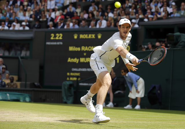 Andy Murray of Britain plays a return to Milos Raonic of Canada during the men's singles final on the fourteenth day of the Wimbledon Tennis Championships in London, Sunday, July 10, 2016. (Andy C ...