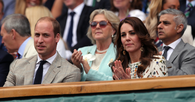 Britain's Prince William and Kate, the Duchess of Cambridge sit in the Royal Box on the fourteenth day of the Wimbledon Tennis Championships in London, Sunday, July 10, 2016. (Andy Couldridge/Pool ...