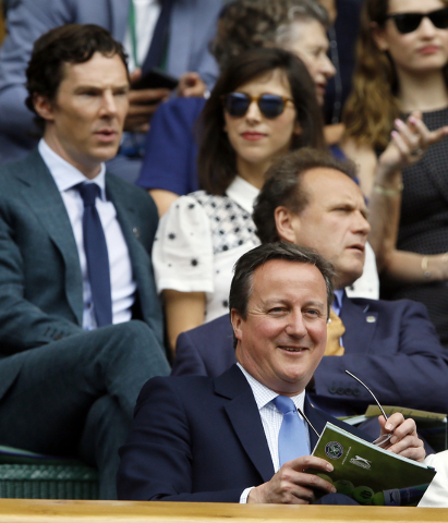 British Prime Minister David Cameron sits in the Royal Box on the fourteenth day of the Wimbledon Tennis Championships in London, Sunday, July 10, 2016. (Kirsty Wigglesworth/Associated Press)