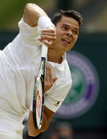 Milos Raonic of Canada returns to serves to Andy Murray of Britain during the men's singles final on the fourteenth day of the Wimbledon Tennis Championships in London, Sunday, July 10, 2016. (Kir ...