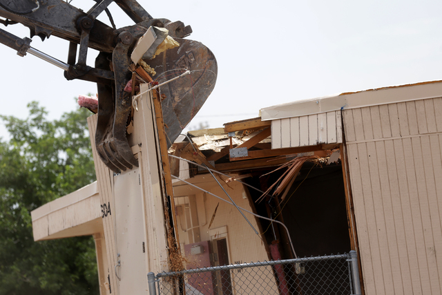 A portable building is demolished at Lincoln Elementary School in North Las Vegas on Tuesday, June 21, 2016. Rachel Aston/Las Vegas Review-Journal Follow @rookie__rae
