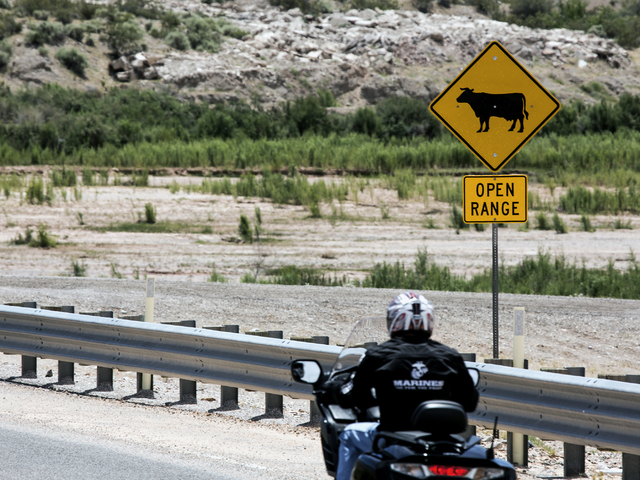 A motorcyclist travels past an open ranch sign on Nevada State Route 170 near the Bundy Ranch on Thursday, May 19, 2016. Jeff Scheid/Las Vegas Review-Journal Follow @jlscheid